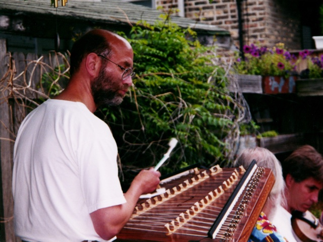 Phil Passen playing Hammered Dulcimer with two toothbrushes for hammers